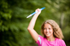 Young sportswoman holding up a javelin Royalty Free Stock Photography