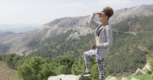 Young sportswoman on mountain stock footage