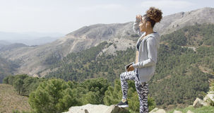 Young sportswoman on mountain Stock Photos