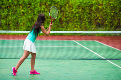 Young sportswoman playing tennis on tropical Stock Images