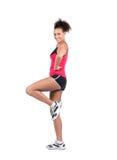 Young sportswoman rises her leg Royalty Free Stock Photos