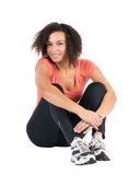 Young sportswoman sits on the ground Royalty Free Stock Image