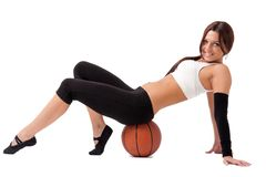 Young sportswoman sitting on basketball Stock Photography