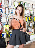 Young sportswoman standing in skirt in sporting goods royalty free stock photo