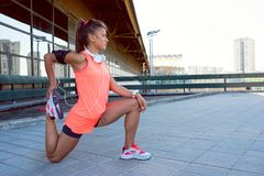 Young Sportswoman Stretching And Preparing To Run stock images