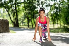 Young sportswoman stretching and preparing to run. Jogger or runner. Cardio. stock photo