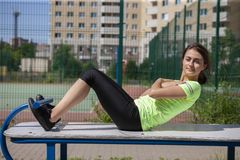 Young sportswoman stretching and preparing to run stock image