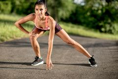 Young sportswoman stretching and preparing to run. Sport Lifestyle. royalty free stock photos