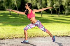 Young sportswoman stretching and preparing to run. Sport Lifestyle. stock image