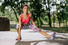 Young sportswoman stretching and preparing to run. Sport Lifestyle. Young sportswoman stretching and preparing to run. Sport Lifestyle stock photography