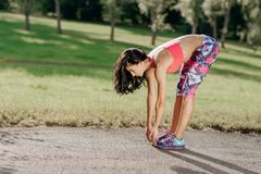 Young sportswoman stretching and preparing to run. Sport Lifestyle. Young sportswoman stretching and preparing to run. Sport Lifestyle royalty free stock images