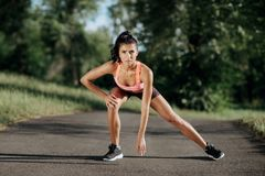 Young sportswoman stretching and preparing to run. Sport Lifestyle. royalty free stock image