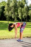 Young sportswoman stretching and preparing to run. Sport Lifestyle. royalty free stock photography