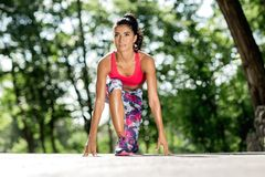 Young sportswoman stretching and preparing to run. Jogger or runner. Cardio. stock photos