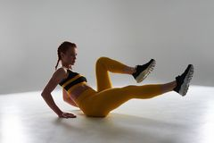 Young sportswoman workin out. In studio Stock Image
