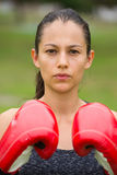 Young sporty attractive woman boxing outdoor Stock Images