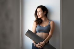 Young sporty attractive woman after practicing yoga royalty free stock images