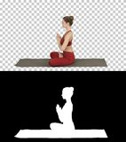 Young sporty attractive woman practicing yoga, doing Lotus pose, Alpha Channel stock images