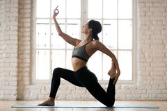 Young sporty attractive woman practicing yoga, Horse rider exerc. Young sporty attractive woman practicing yoga, doing Horse rider exercise, anjaneyasana pose royalty free stock photography