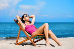 Young, sporty, beautiful and happy woman relaxing Stock Image