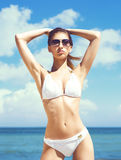 Young, sporty, beautiful and sexy woman in swimsuit posing on a Royalty Free Stock Images