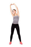 Young sporty beautiful woman stretching arms and back Royalty Free Stock Photo
