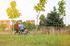 Young Sporty Biker Couple in Sunny Day Outdoors. Horizontal Image Royalty Free Stock Image