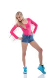Young sporty blonde isolated on white Royalty Free Stock Image