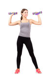 Young sporty blonde woman exercising with aerobic foam dumbbells Stock Photography