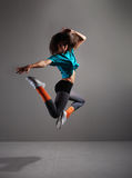 A young and sporty brunette dancer in motion Royalty Free Stock Photo