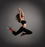 A young and sporty brunette woman in a jump Royalty Free Stock Photos