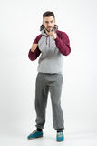 Young sporty casual man in sportswear with boxing hand gesture Stock Images