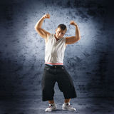 A young and sporty man doing a modern dance pose Stock Photos