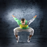 A young and sporty man doing a modern dance pose Stock Images
