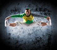 A young and sporty man doing a modern dance pose. A young and sporty Caucasian man in attractive clothes doing a modern dance pose. The image is taken on a stock photo