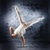 A young and sporty man doing a modern dance pose Royalty Free Stock Photos