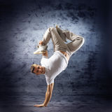 A young and sporty man doing a modern dance pose Stock Image