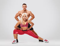 Young sporty couple posing Royalty Free Stock Images