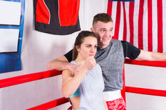 Young sporty couple resting after workout leaning over red ropes Stock Photos