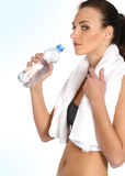 A young and sporty female drinking water Royalty Free Stock Image