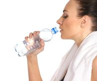 A young and sporty female is drinking water Royalty Free Stock Image