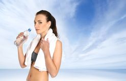 A young and sporty female is drinking water Stock Photography