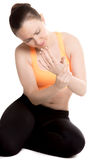 Young sporty female rubbing sore wrist Royalty Free Stock Photos