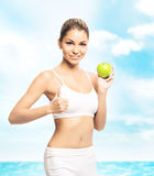 Young, sporty, fit and beautiful girl with the apple isolated on Stock Images