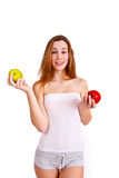 Young, sporty, fit and beautiful girl with apples isolated on wh Royalty Free Stock Photography