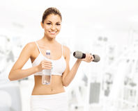 Young, sporty, fit and beautiful girl with a dumbbell Royalty Free Stock Photography