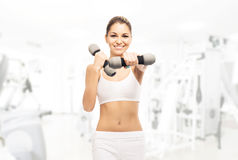 Young, sporty, fit and beautiful girl with dumbbells Stock Image