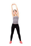 Young sporty fit blonde woman stretching arms and back Royalty Free Stock Photography