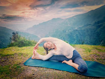 Young sporty fit woman doing Hatha Yoga asana Stock Image