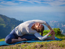 Young sporty fit woman doing Hatha Yoga asana Royalty Free Stock Photography